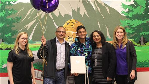 Chirag with his parents and UW Admissions representatives