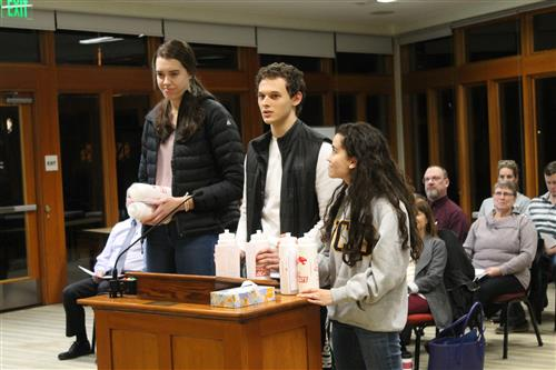 Mount Si High School ASB student present the Board with Wildcat water bottles.