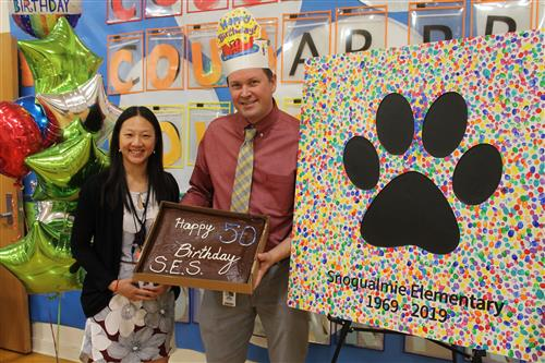 Principal John Norberg and Asst. Principal Valerie Li launch the lunchtime 50th celebration.